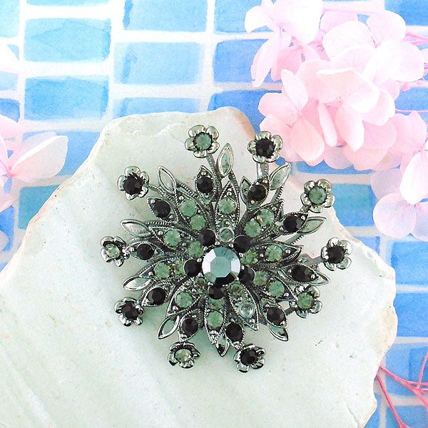 CO-134: Austrian crystal studded flower brooch