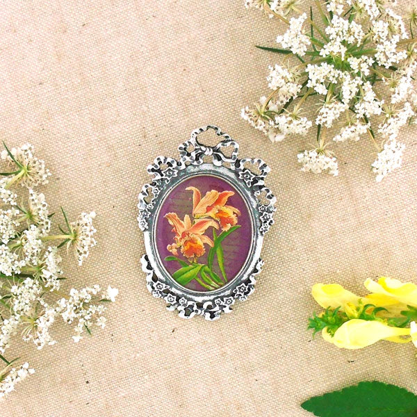 Shop LAVISHY's unique, beautiful & unique handmade vintage style pin/brooch with orchid flower print & French Rococo style frame. A great gift & a collector's piece. Wholesale available at www.lavishy.com with many unique & fun fashion accessories.