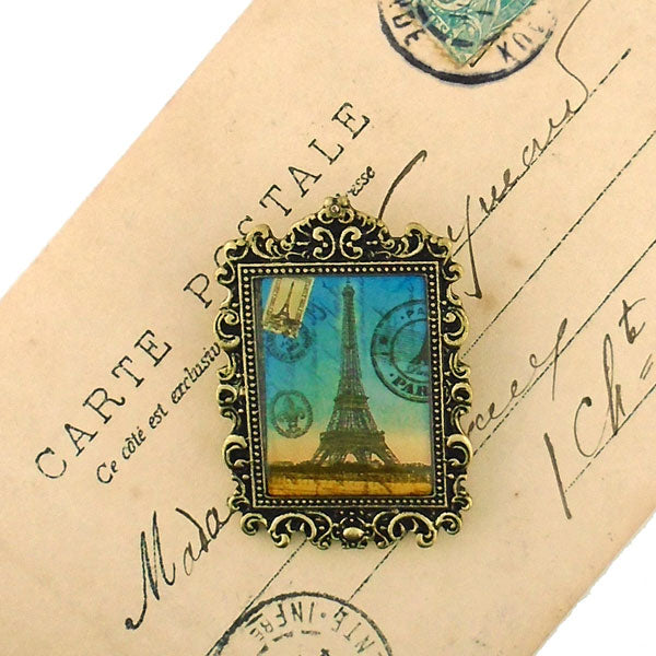 Shop LAVISHY's unique, beautiful & unique handmade vintage style pin/brooch with Paris Eiffel Tower print & French Rococo style frame. A great gift & a collector's piece. Wholesale available at www.lavishy.com with many unique & fun fashion accessories.
