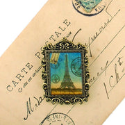 Online shopping for LAVISHY's original, beautiful & affordable handmade vintage style pin/brooch with Paris Eiffel Tower print & French Rococo style frame. A great gift & a collector's piece. Wholesale at www.lavishy.com for gift shops, clothing & fashion accessories boutiques, book stores, souvenir shops.