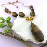 Online shopping for handmade tiger's eye stone and glass beads designed and handmade by LAVISHY in Toronto Canada. Tiger's eye is the stone of protection, may bring good luck to the wearer. It has the power to focus the mind, promoting mental clarity, assisting us to resolve problems objectively and unclouded by emotions.