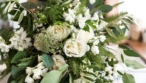 Kim & Dylan's lush foliage inspired wedding flowers