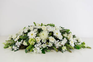 SEASONAL WHITE CASKET SPRAY