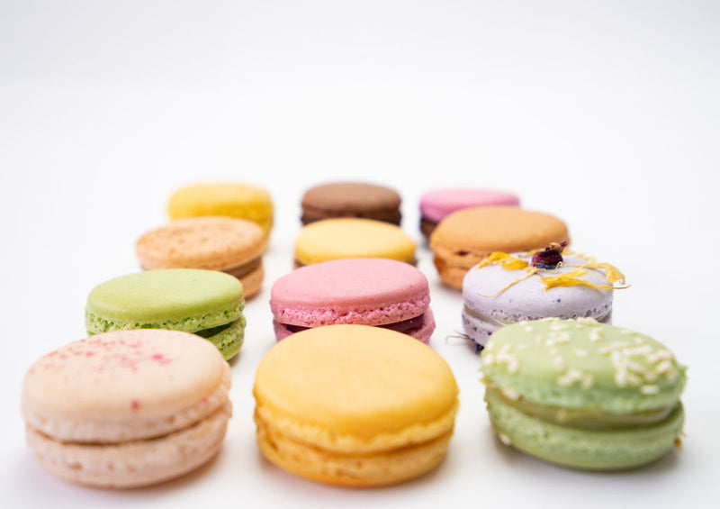 12 various macaron flavours arranged in a grid