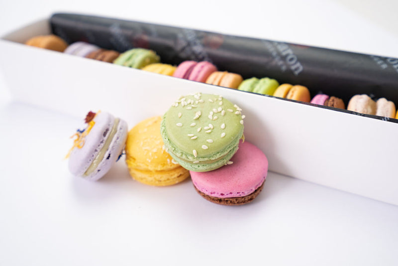12 macaron flavours in a gift box packaging