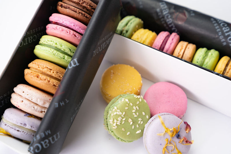 2 boxes of macarons arranged nicely