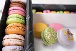 Arrangement of 24 macarons of varying flavours
