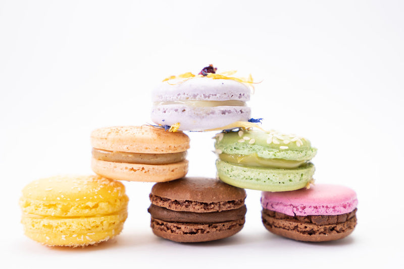 Arranged tower of 6 different macaron flavours