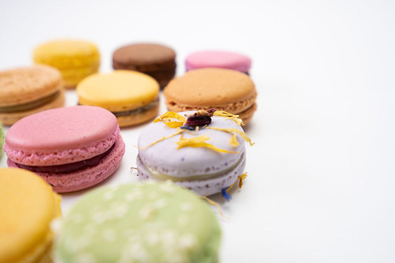60 tasty French macarons arranged for enjoyment