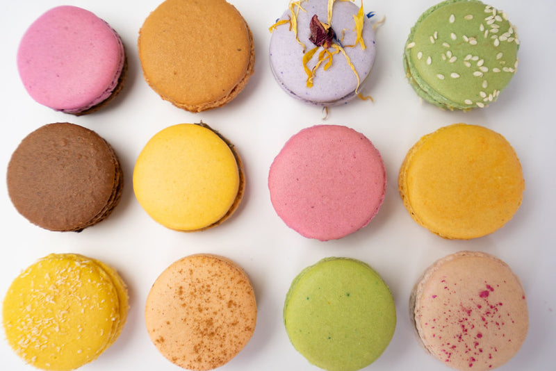 Mixed macaron flavours arranged in a group