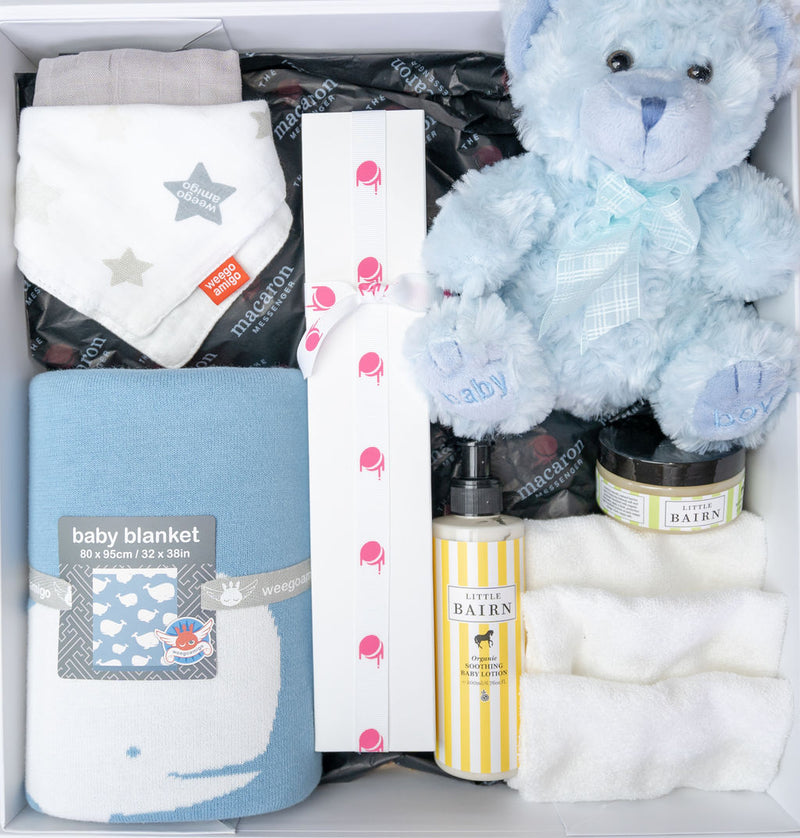 top view of gift hamper with baby boy presents