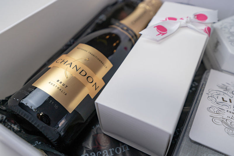 champagne sparkling wine with macarons in gift hamper