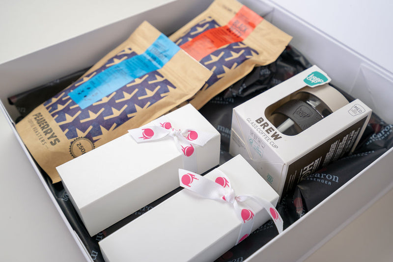 Macaron gift box with afternoon tea drinks