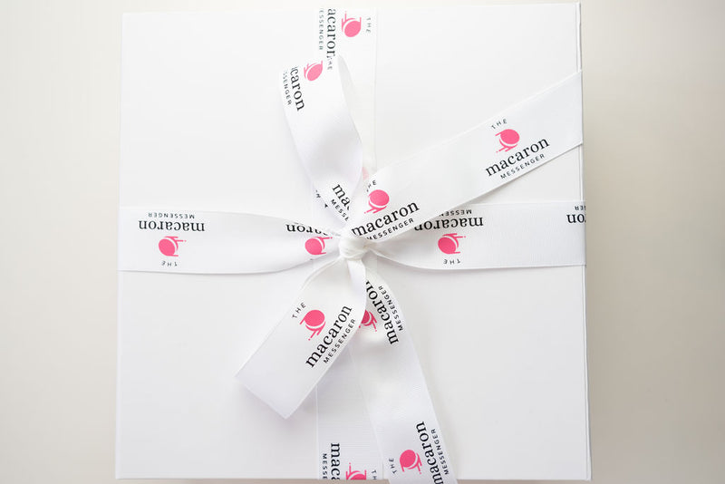 baby shower gift hamper packaging with macaron messenger ribbon