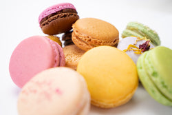A pile of 30 mixed macaron flavours