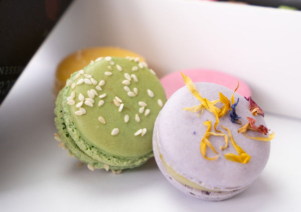 close up of elderflower and green tea macarons