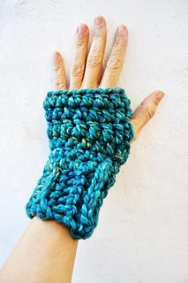 a left hand on a white background wearing a very vibrant blue fingerless hand warmer