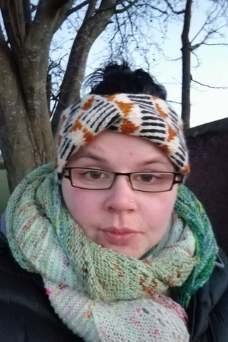 oh its me again. walking in the woods. More covid hair top knots, a black and white and gold knitting headband is covering most of the hair mess. i have a mint green knitted shawl that is huge wrapped round my neck and i feel warm just looking at this, i look like a poser. HA