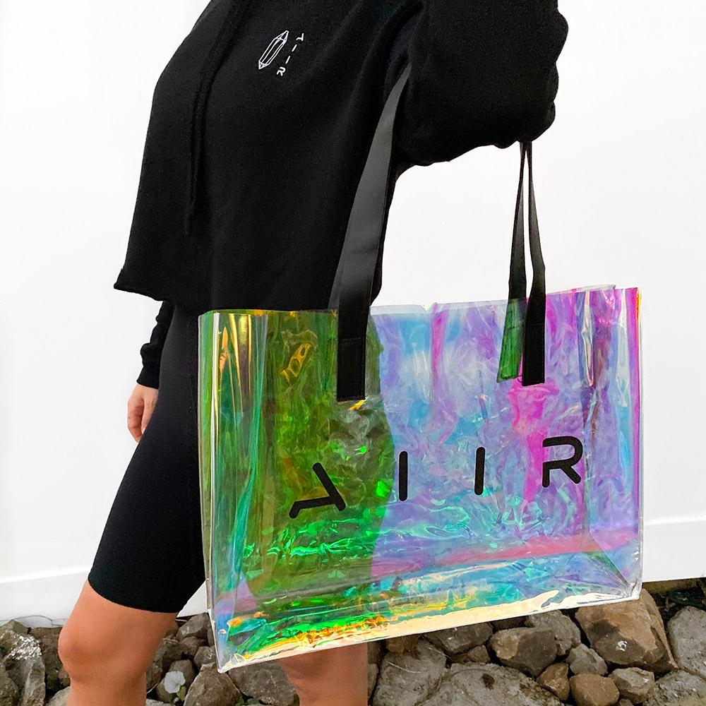 Transparent holographic tote with black shoulder straps