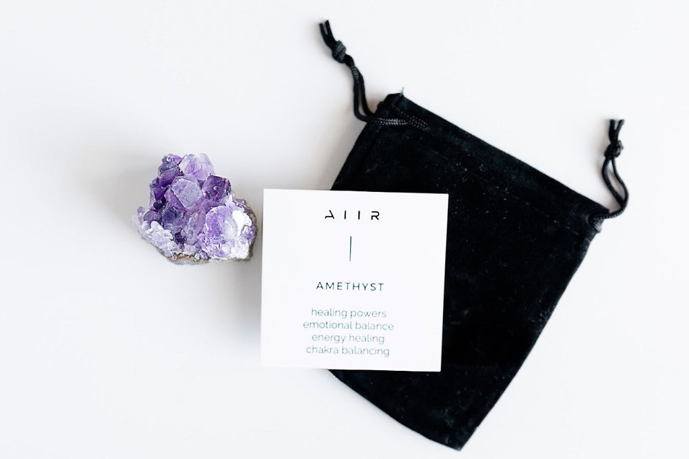 Amethyst crystal with carrying pouch and info card