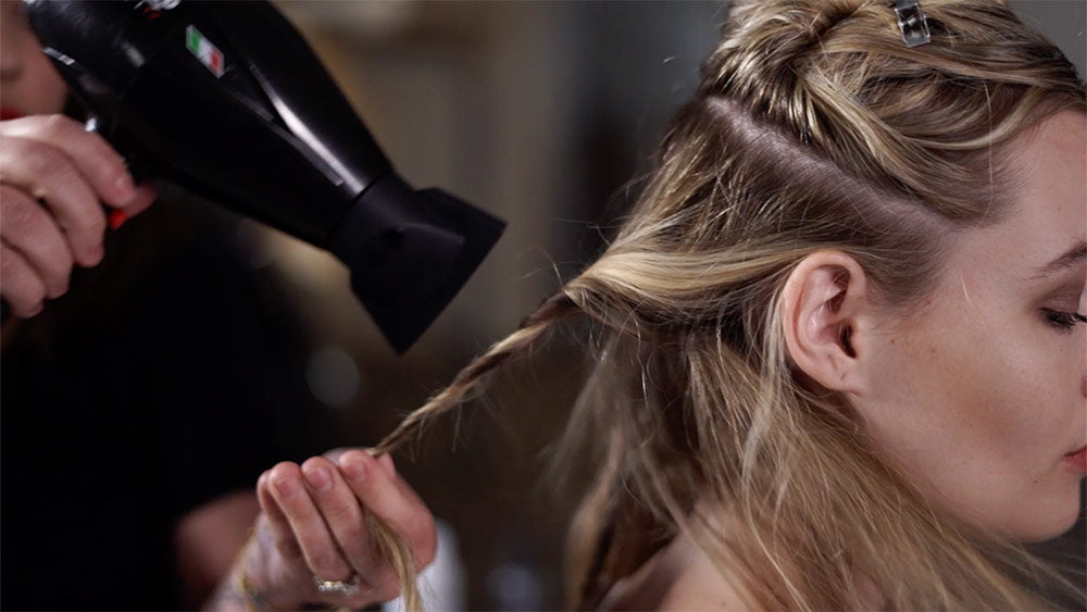 twist a 1/2 inch section of hair and blow dry for 15 seconds to create beach waves