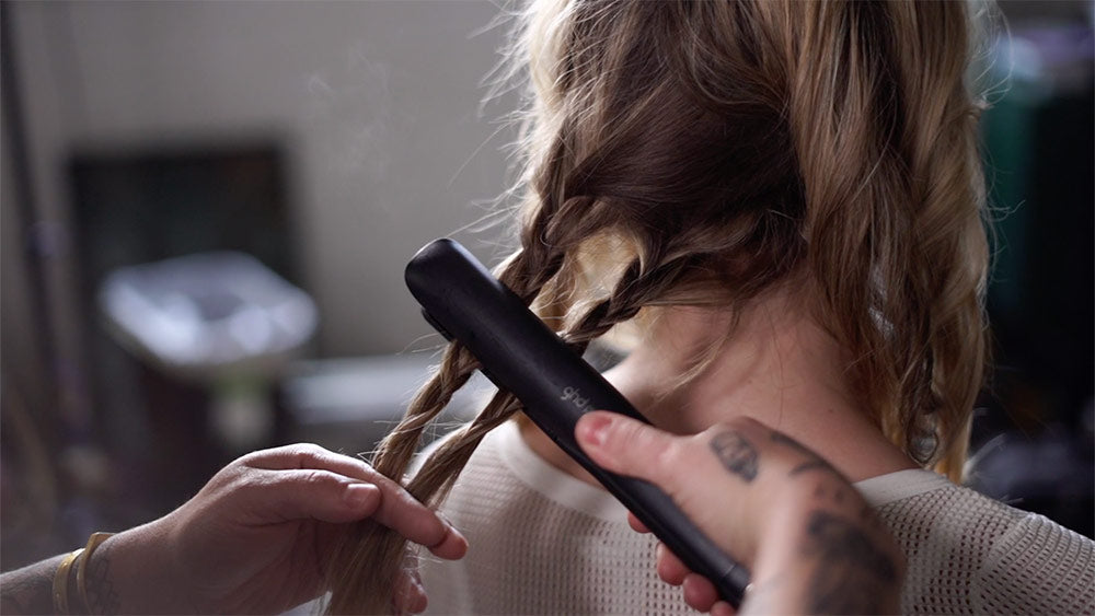 using a flat iron and braids to create effortless beachy waves