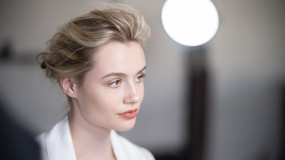 low chignon hairstyle created with dry texture spray