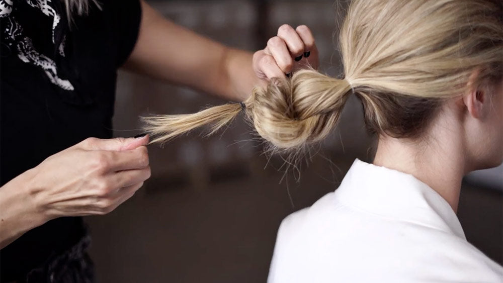 low chignon tutorial pull out twist to create extra volume