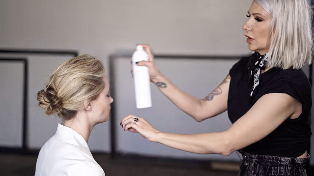 low chignon tutorial spray low chignon with AIIR texture spray for extra hold and texture