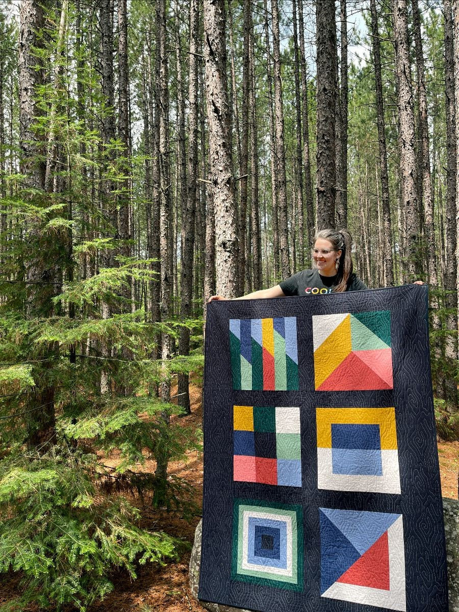 Erin Holding Boreal Forest Cover Quilt 2