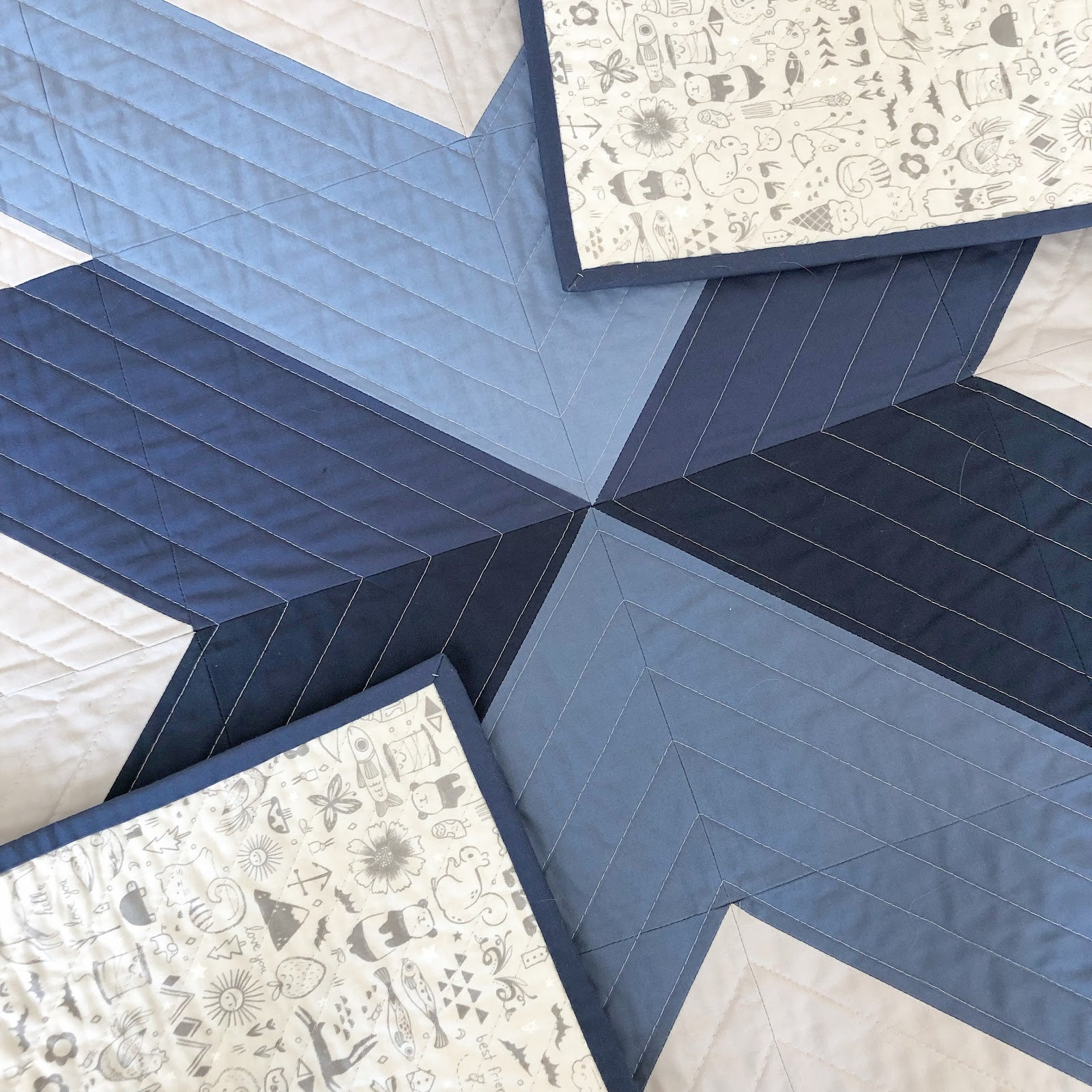 Blue Grey Cross Lake Quilt Close Up and Backing