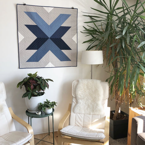 Blue Grey Cross Lake Quilt Hanging On Wall