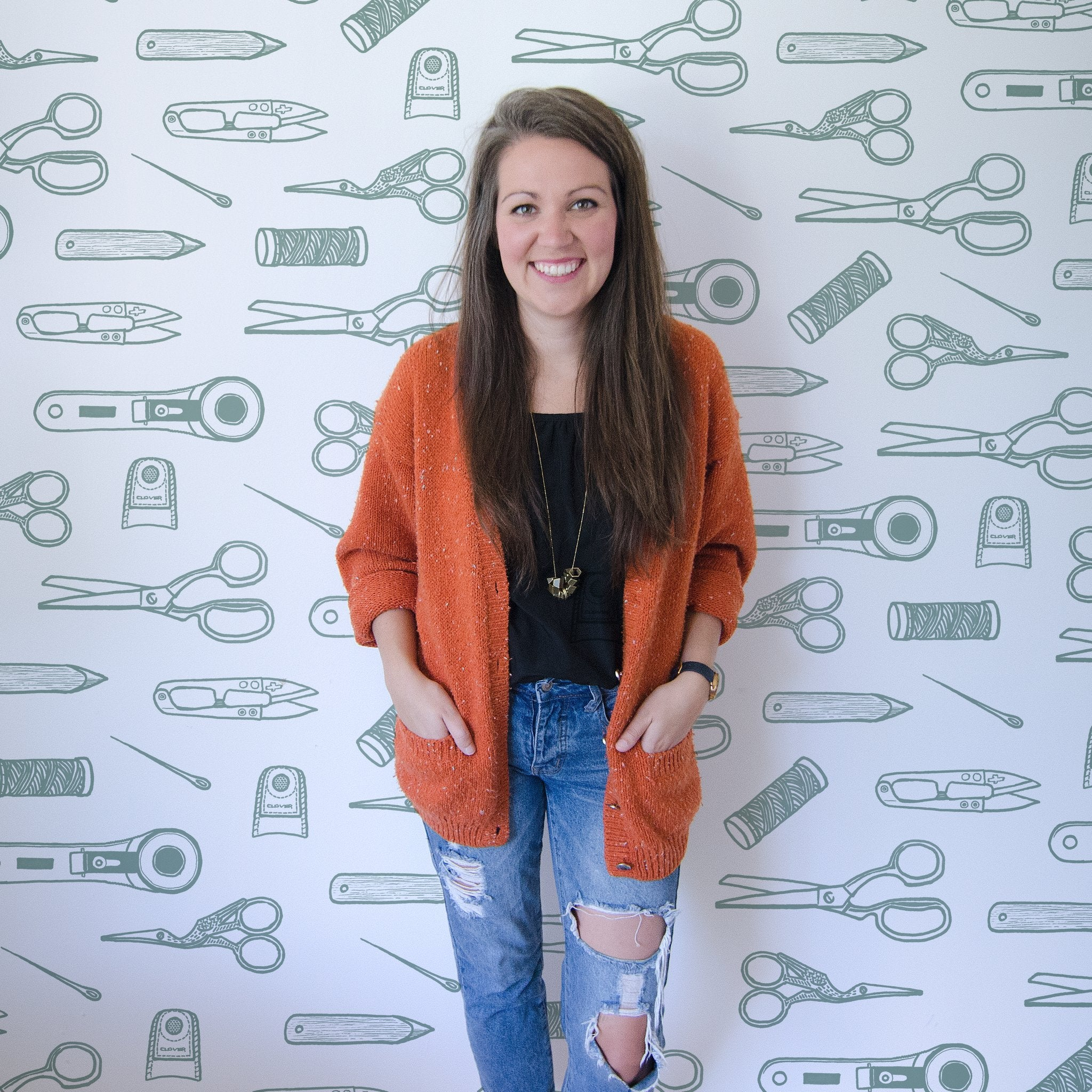 Erin Kroeker of The Blanket Statement with quilting tools backdrop.