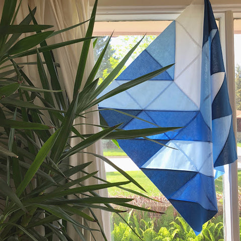 Dark Blue Pine Falls Quilt Hanging In Window