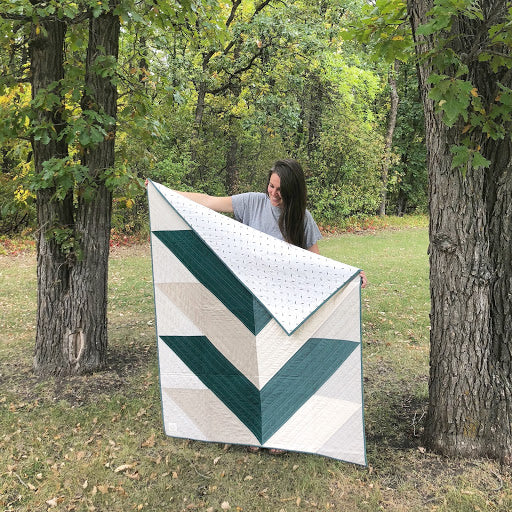 Erin Holding Green Reclaimed Fabric Pine Falls Quilt