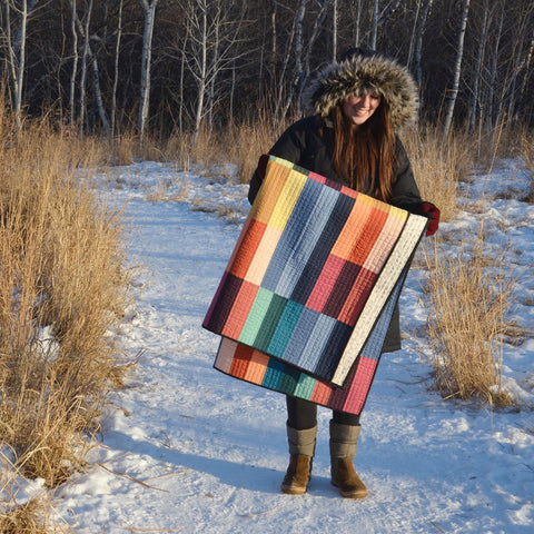 Erin Holding Paint Lake Cover Quilt