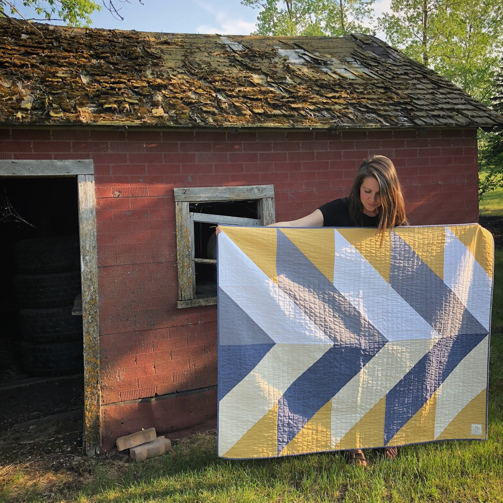 Erin Holding Yellow Reclaimed Fabric Pine Falls Quilt
