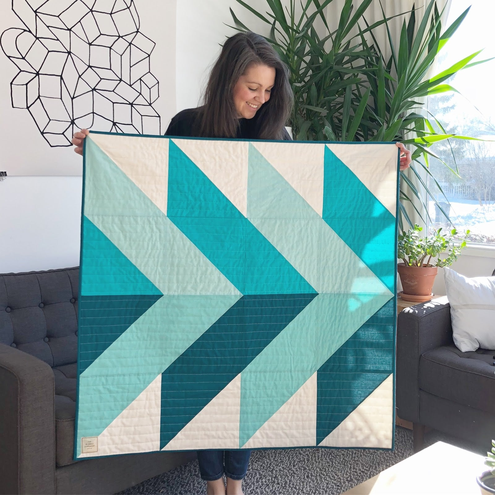 Erin Holding Turquoise Pine Falls Quilt