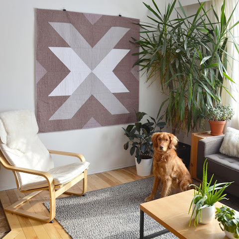 Essex Linen Cross Lake Quilt Hanging On Wall With Finley