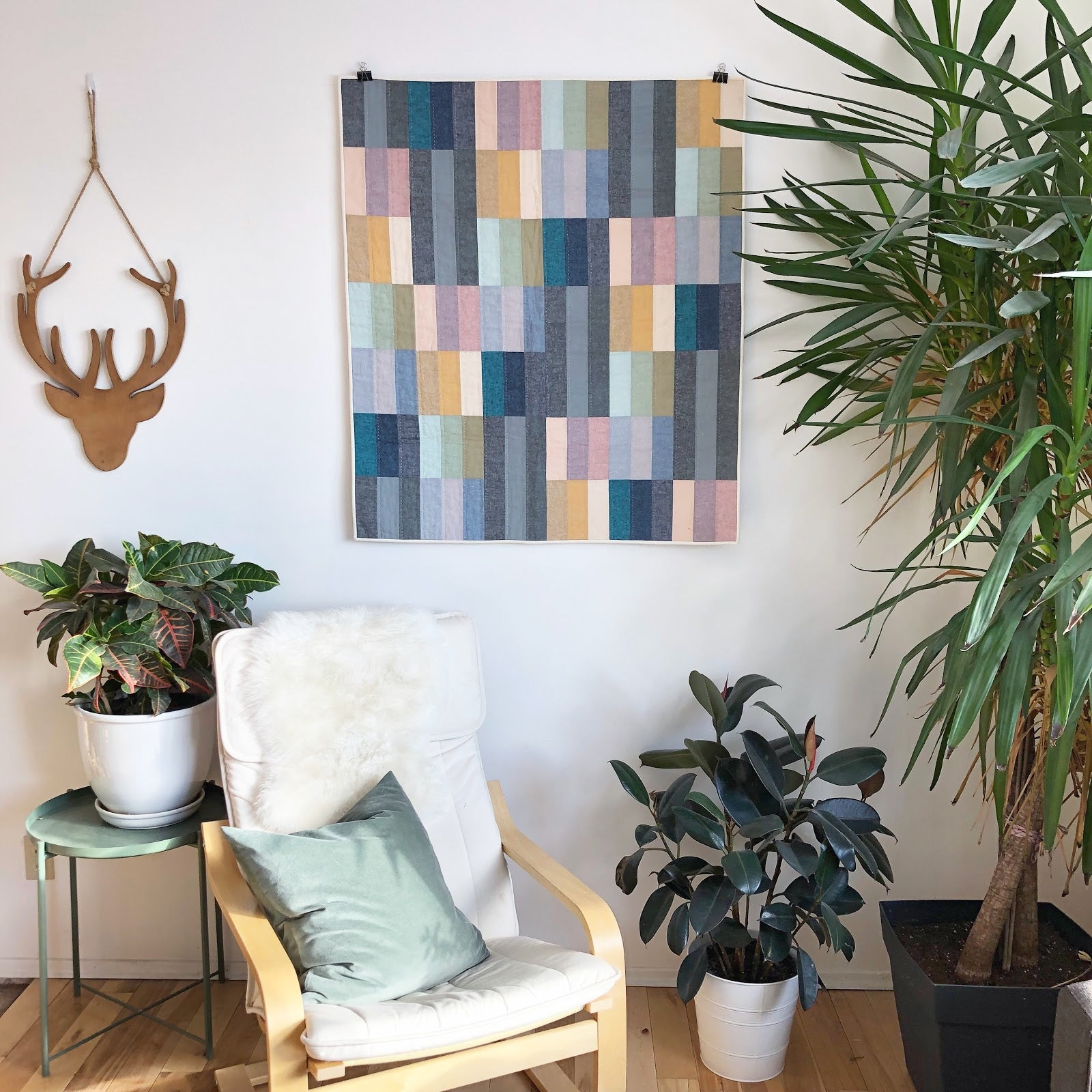 Essex Linen Paint Lake Quilt Hanging On Wall