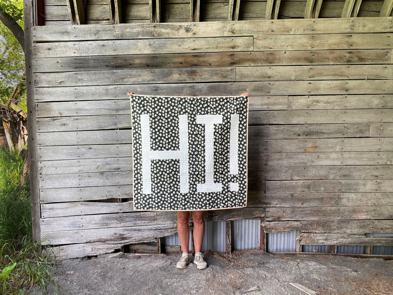 Erin Holding HI Quilt Wood Wall