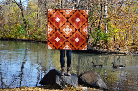 Holding Spruce Woods Cover Quilt With Ducks