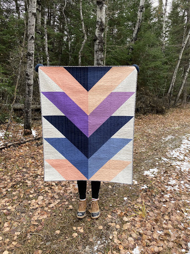 Holding Up Kona Cotton Pine Falls Quilt In Trees