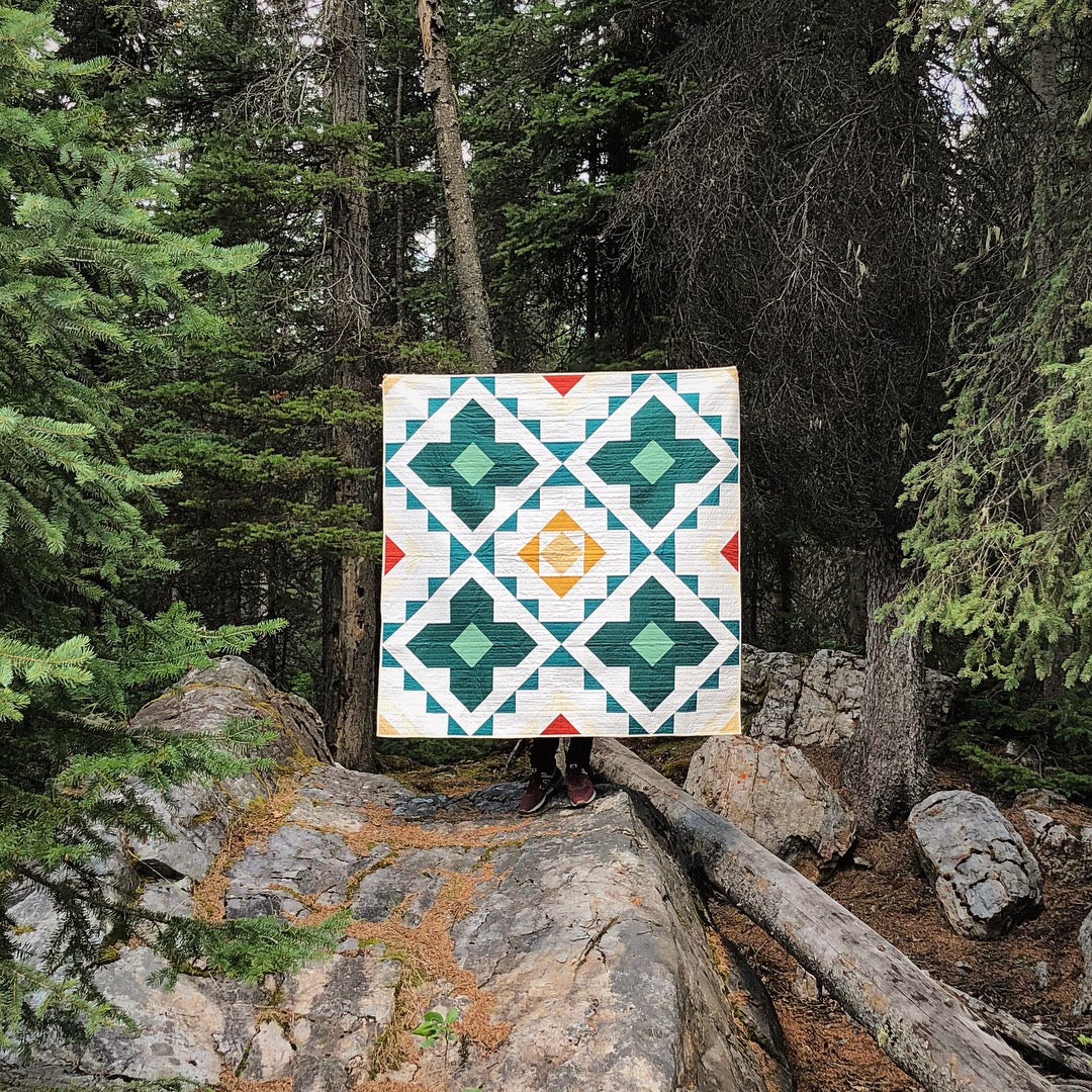 The Spruce Woods Quilt surrounded by beautiful forest.