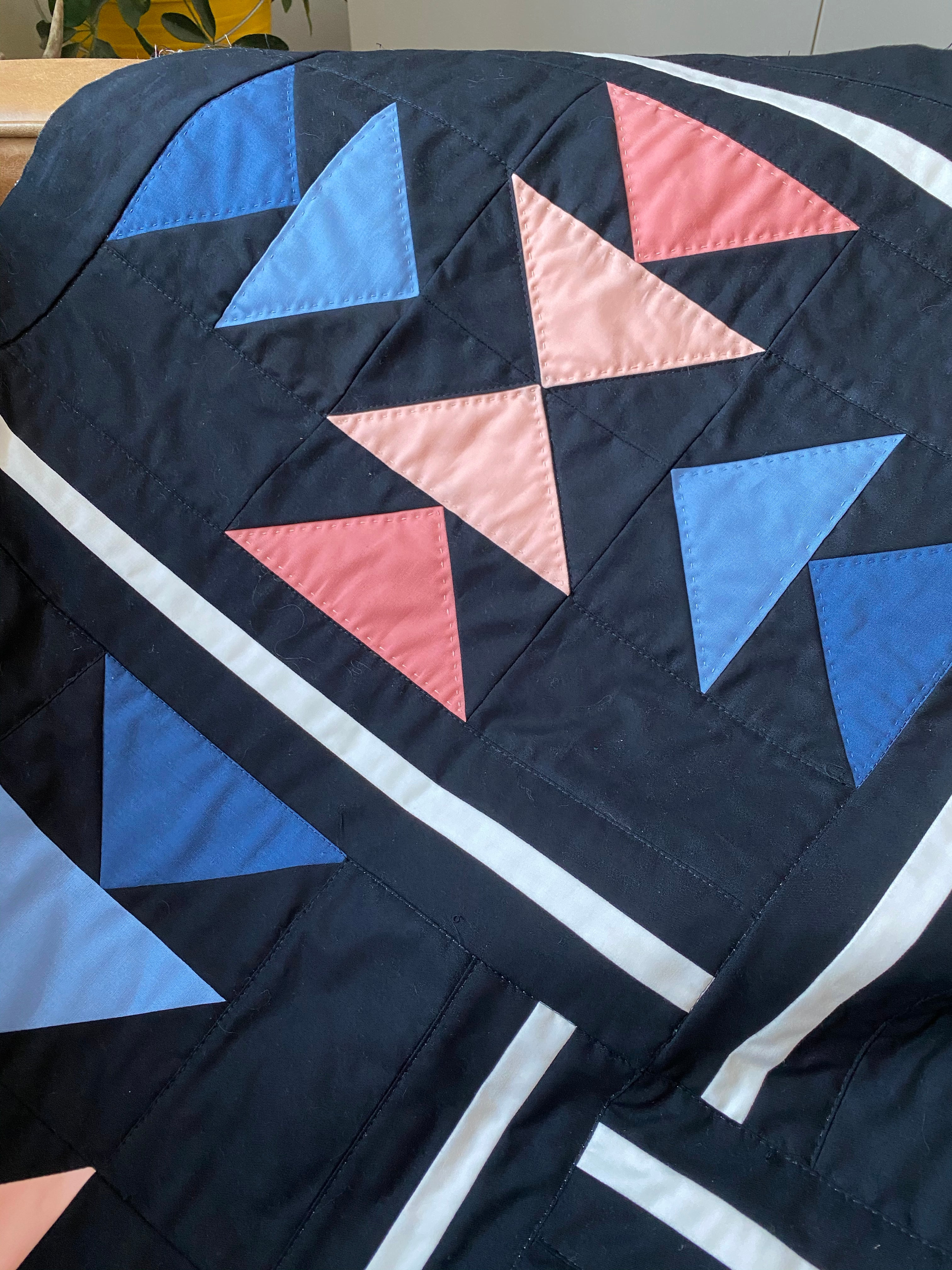 Up close picture of the Landmark quilt block, with hand quilted details.