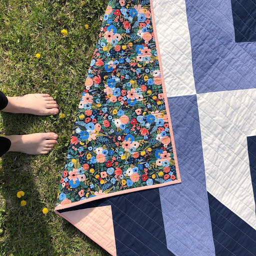 Rifle Paper Cross Lake Quilt On Grass With Bare Feet