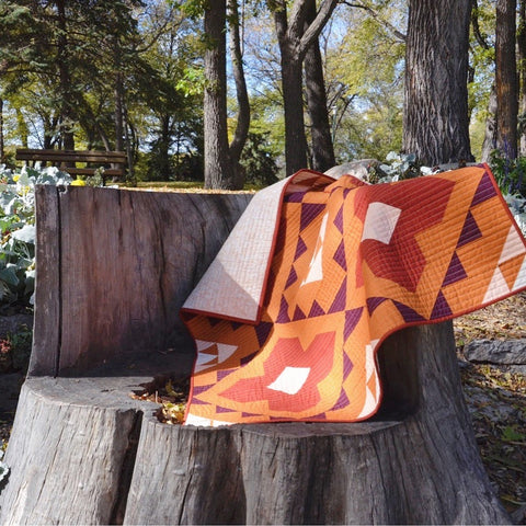Spruce Woods Cover Quilt On Tree Stump