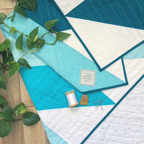 Turquoise Pine Falls Quilt With The Blanket Statement Label