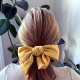 Large Bow in Gold with Hair Clip Fastener at Born In The Sun - Borninthesun