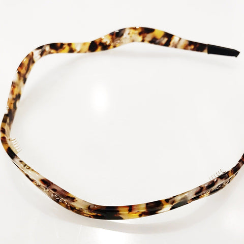 Tortoiseshell Acetate a mix of brown and black colours in zig zag shape with an element of sparkle Hairband at Born In The Sun - Borninthesun